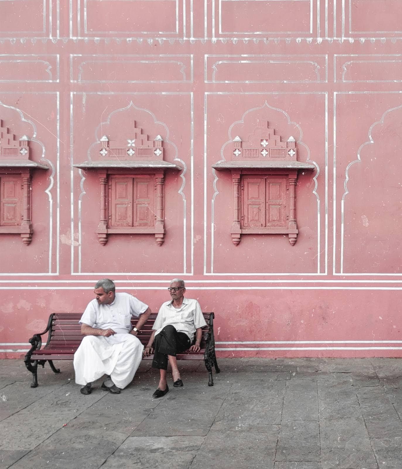Old men sitting in pink city